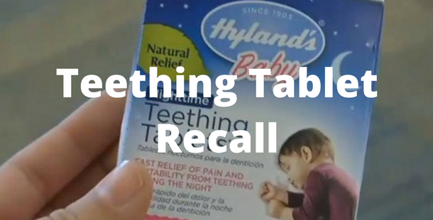 Person holding box of recalled baby teething tablets